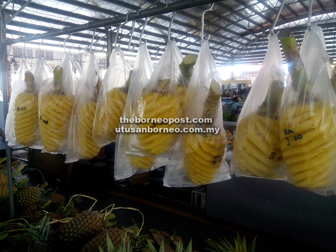 Ready-to-eat pineapples at Asinah's stall at Sarikei Wet Market.