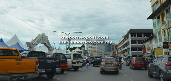 The new Limbang town commercial area is congested with limited parking space.