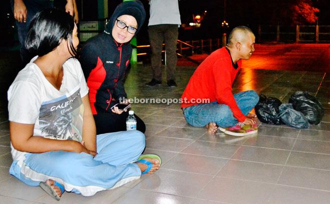 Fatimah talks to a vagrant at the Bintulu Esplanade.