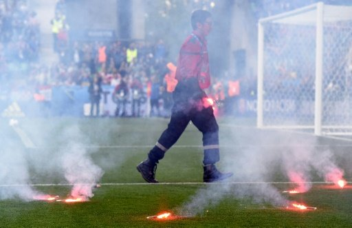A fire fighter extinguish flares lobed onto the pitch during the Euro 2016 group D football match between Czech Republic and Croatia at the Geoffroy-Guichard stadium in Saint-Etienne on June 17, 2016 -AFP photo