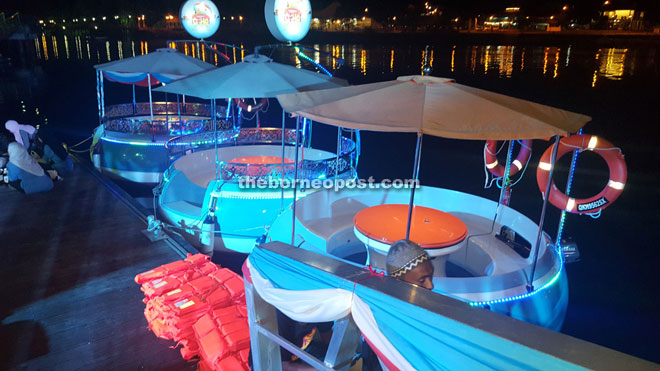 The donut boats being docked at a platform behind Grand Margherita Hotel at the end of Kuching Waterfront.
