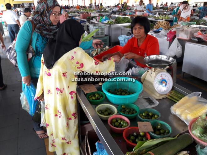 Customers buying grocery at Sarikei market.