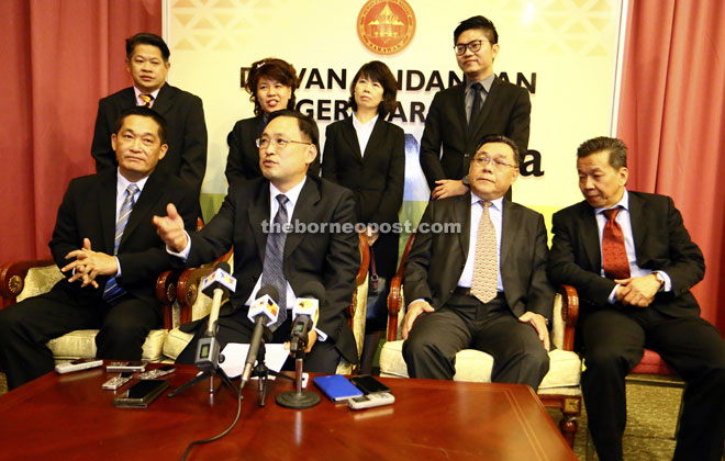 Chong (seated second left) speaking during the press conference alongside See (seated left), Yong (standing second left), Wong (standing right) and other DAP elected representatives. — Photo by Kong Jun Liung