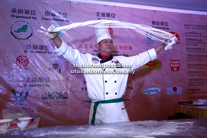 A chef displays his noodle-making skills at the exhibition area.