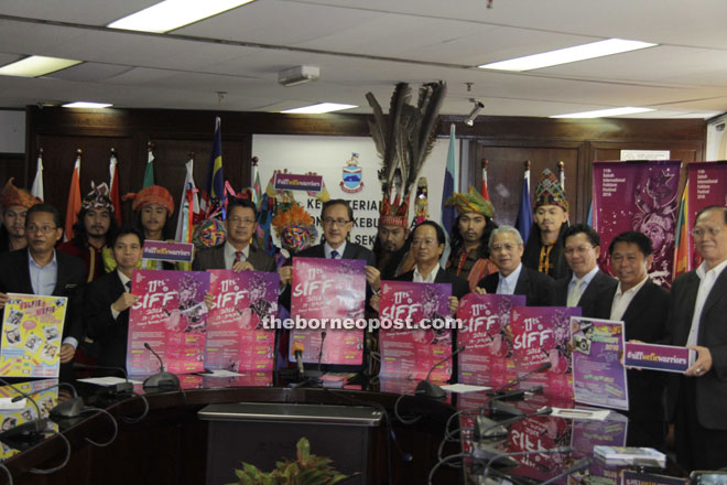 Masidi (fourth left) with the posters that will be used to promote the 11th SIFF.