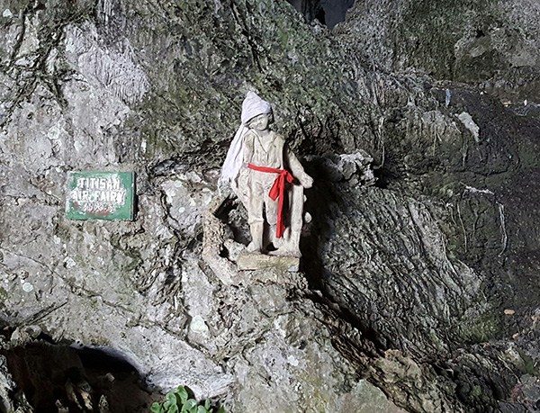 A child-like figure placed in the cave.