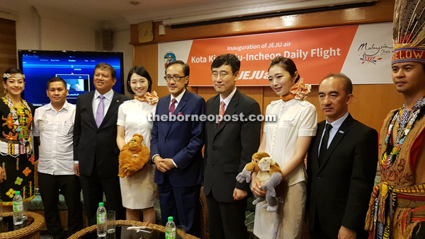 Masidi (centre), Lee (fourth right), Bangkuai (third left) and Yapp (second right) at the Jeju Air inauguration press conference at Sabah Tourism Board building in Kota Kinabalu yesterday.
