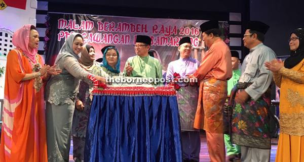 Abang Johari (centre), flanked by his wife Datin Amar Juma'ani Tuanku Bujang and Fadillah, having a light moment with other guests after the cake-cutting ceremony. Sharifah Hasidah is at second left.