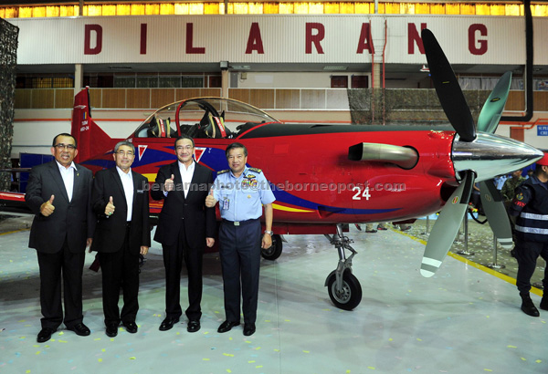 (From left) Johari, Ahmad Bashah, Hishammuddin and Roslan at the RMAF's Hari Raya celebration and launching of the Pilatus PC-7 Mk II aircraft and EC 120B helicopters. — Bernama photo