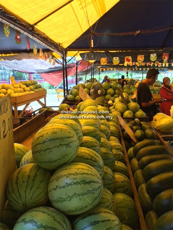 Watermelons and honeydews at the market of Sipitang.