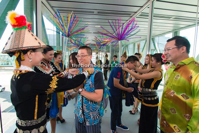 The travel agents from Yunnan Province being welcomed at the airport. Looking on at right is Pang.