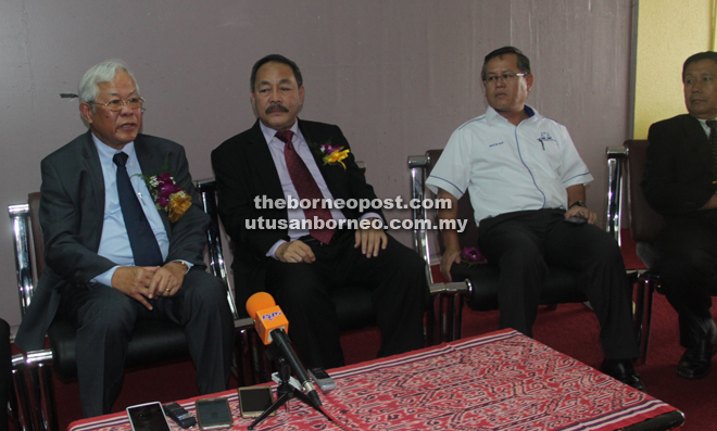 Manyin (left) speaks to the media as (from right) Bukit Semuja assemblyman John Ilus, Kedup assemblyman Martin Ben and Assistant Minister for Public Utilities (Water Supply) Roland Sagah look on.