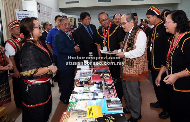 Uggah (third right) visiting a booth at MIPCE II.