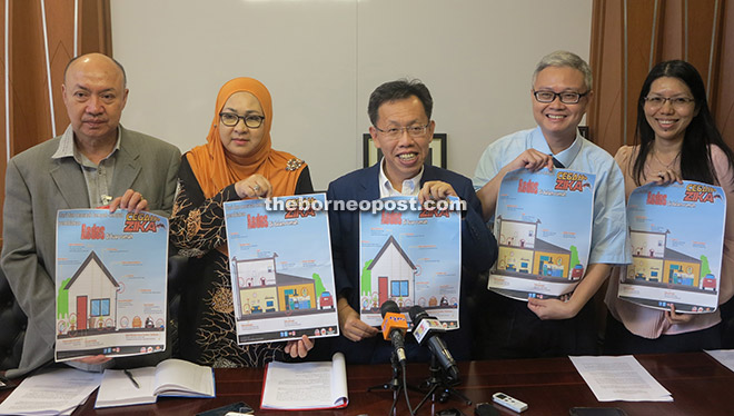 From left: Dr Andrew, Dr Jamilah, Dr Sim, Dr Chua, and Dr Lee showing posters on eliminating breeding places of mosquitoes during the press conference.