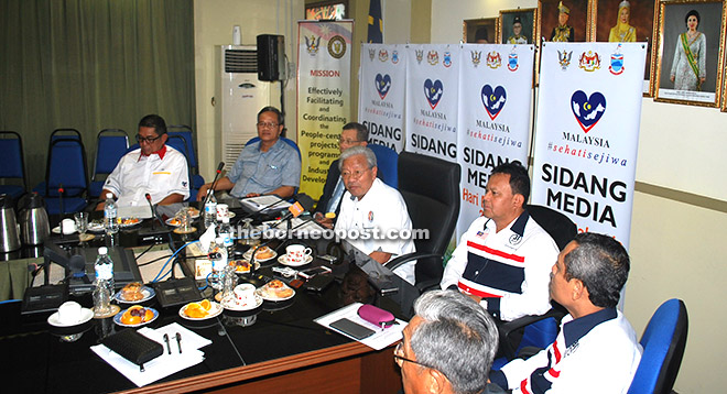 Masing (fourth left) fields question from the media during the press conference.