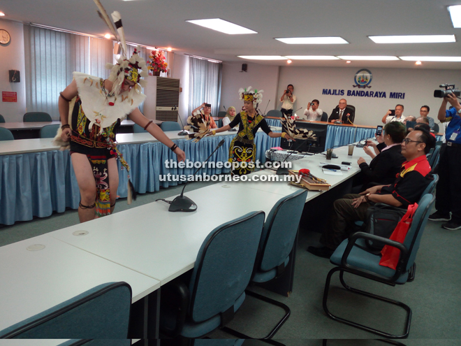 Orang Ulu dancers presenting a traditional dance during the courtesy call.