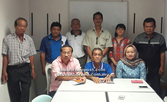 Sebastian (seated centre) and his committee members at the branch committee meeting.