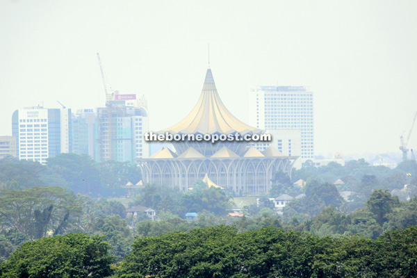The State Legislative Assembly building and other buildings are shrouded in haze as seen from the Kuching North City Commission (DBKU) headquarters at noon yesterday. — Photo by Jeffery Mostapa