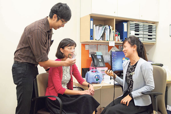 (Left) Mr Goh Huai Zhi (standing) and Ms Brenda Boh (right) wanted a simple and convenient tool to help speech therapists identify patients at risk of silent aspiration, a potentially dangerous condition for patients with swallowing difficulties. • (Above) The study involved patients having to inhale varying concentrations of citric acid to identify which brought on coughing.
