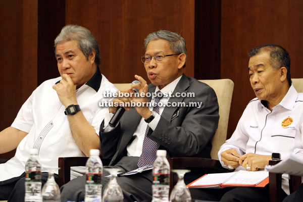 Mustapha (centre) addresses the meeting. Also seen are Awang Tengah (left) and Naroden.