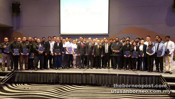 (Front from seventh right) Vignaesvaran, Lee, Mohd Gazali, Brinckmann, and Thiagaraja are seen with the graduates.