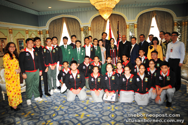 Adenan (eighth right) posing for a group photo with SMK St Joseph Marching Band who did Sarawak and Malaysia proud at the recent USBands Yamaha Cup Competition held at Metlife Stadium in New Jersey, USA last month. — Penerangan photos
