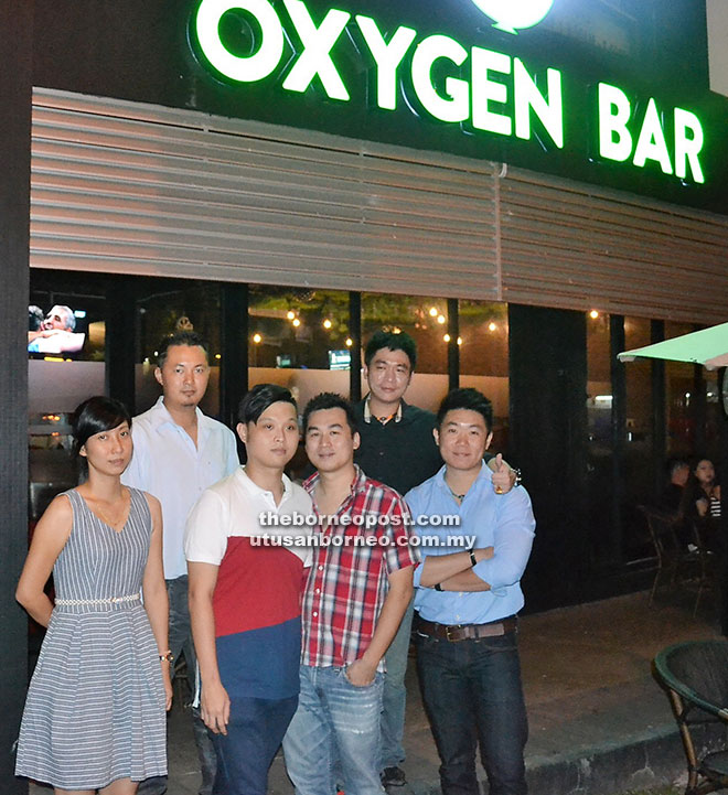 Ling (front row, second right) with his business partners outside the Oxygen Bar.