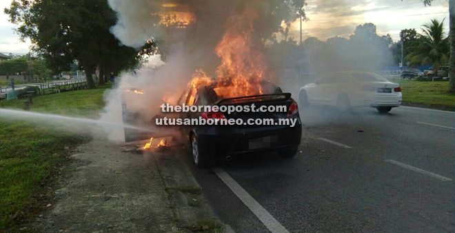The car engulfed in flames.