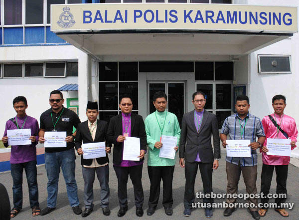 Azrul (fourth right) with Bersama members after lodging a police report yesterday.