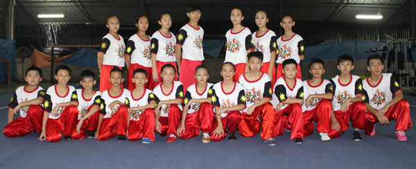 The Sarawak wushu team in a group photograph before a training session at the Sarawak Wushu Elite Training Centre at Kota Sentosa Sports Centre, Stakan recently.