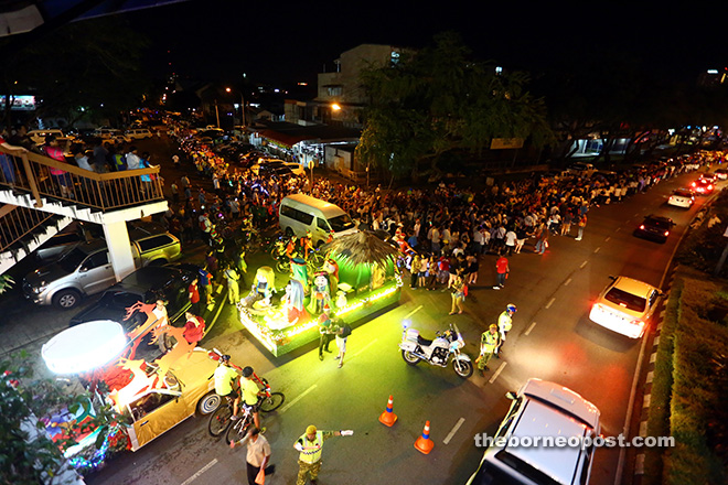 WALK OF JOY: Thousands of Christians gather at the Jubilee Ground for the Kuching Christmas Parade last night. The annual parade was a delightful profusion of both religious and traditional festive imagery. — Photo by Muhd Rais Sanusi