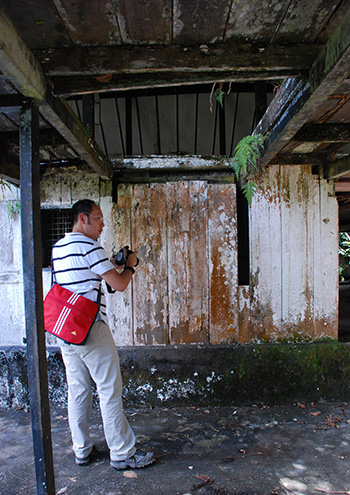 John Ting taking photos at Fort Alice before conservation works started. — Photo by Mike Boon.