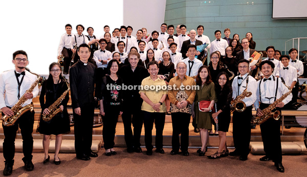 Uggah and Dr Sim (front, fifth right and centre, respectively) with members of the organising committee and performers of 'A Brass Spectacular' at Trinity Methodist Church Kuching. Also in the group photo are Ling and Fox (fourth and fifth left, respectively).