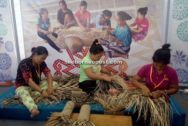The women from the Penan Murum community demonstrate their skills at the festival.