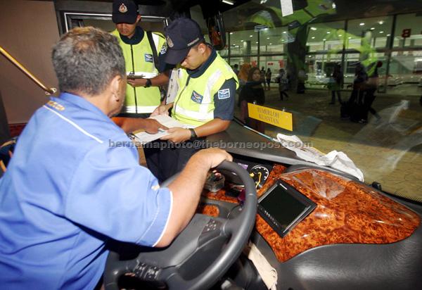 SPAD personnel conducting checks during an operation at Kelantan Sentral Terminal in Kuantan. — Bernama photo