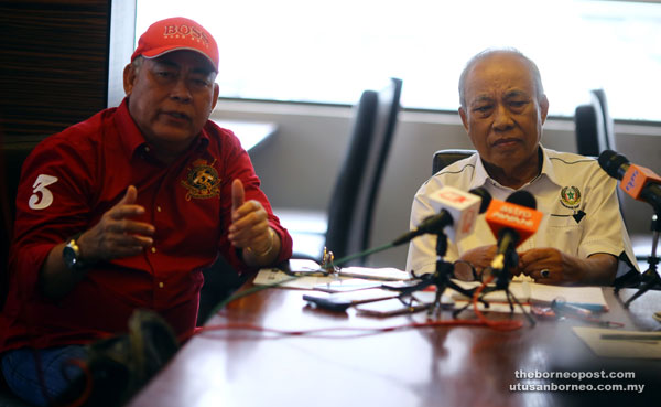 Saidi (left) explaining a point during the press conference. Also seen is Abang Nawawi. — Photo by Muhammad Rais Sanusi