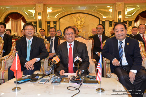 Abang Johari, flanked by Second Finance Minister Dato Sri Wong Soon Koh (right) and China Consul-General in Kuching Fu Jijun, speaks to reporters at the press conference.
