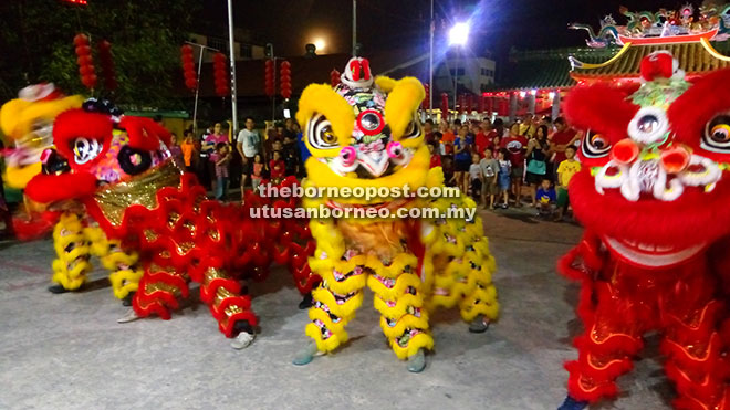 The lion dancers in action.