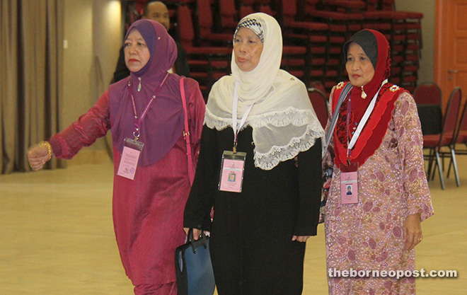 Jamilah (centre), flanked by her proposer and seconder, enters the nomination centre. – Photo by Chimon Upon