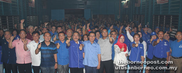 Dr Rundi together with BN leaders and the people of Kpg Sungai Lundu pose for a group photo after the 'Leader-Meet-the-People' session at Kpg Sungai Lundu, near Lundu Town on Monday night. Watson is seen at (second right front row). Also seen are Azizul (fifth right), Sagah (sixth left), Gerald (fourth left), Simoi (fourth right) and Minos (behind Sagah).