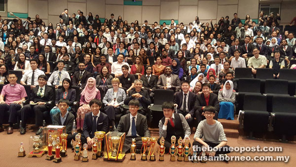 St Joseph debaters (front) with other participants and guests-of-honour after the prize presentation.