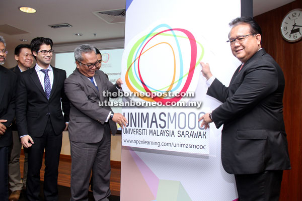 Nanta (right) and Kadim (second, right) launching the Unimas MOOC at Unimas' Centre of Teaching Facilities 3 (CTF3) yesterday. Also seen is Adam (left). — Photo by Chimon Upon