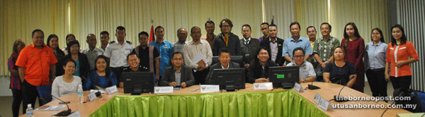 Belayong (seated fourth right) posing for a group photo with organising committee members after the meeting.