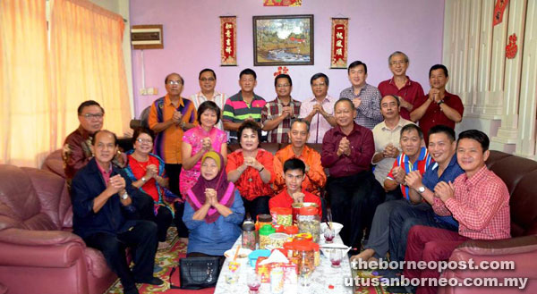 (Seated from sixth right) Penguang and his wife Datin Monica Ukong are seen at Kiu's (seated fifth right) open house.
