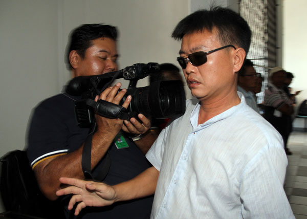 Leong exiting the court after the Magistrate's Court fixed March 13 for a re-mention of the case involving the owner of the catamaran that capsized while heading to Pulau Mengalum. — Bernama photo