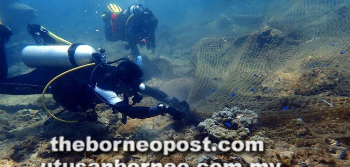 Divers clear 'ghost nets' to save coral reefs off Miri shores