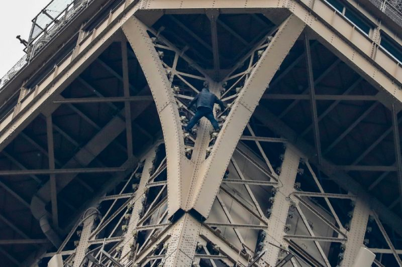 Eiffel Tower evacuated as man seen climbing the landmark