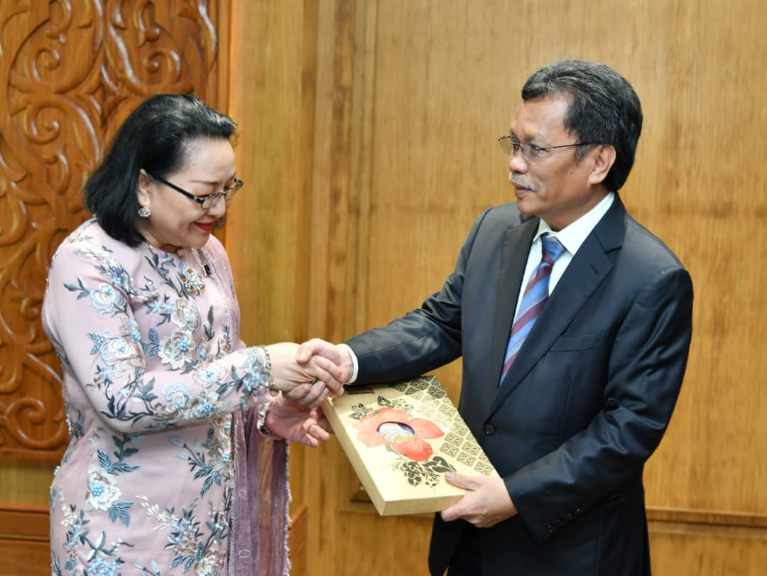 Shafie (right) with Mistirine during their meeting at the Sabah Administrative Centre yesterday.